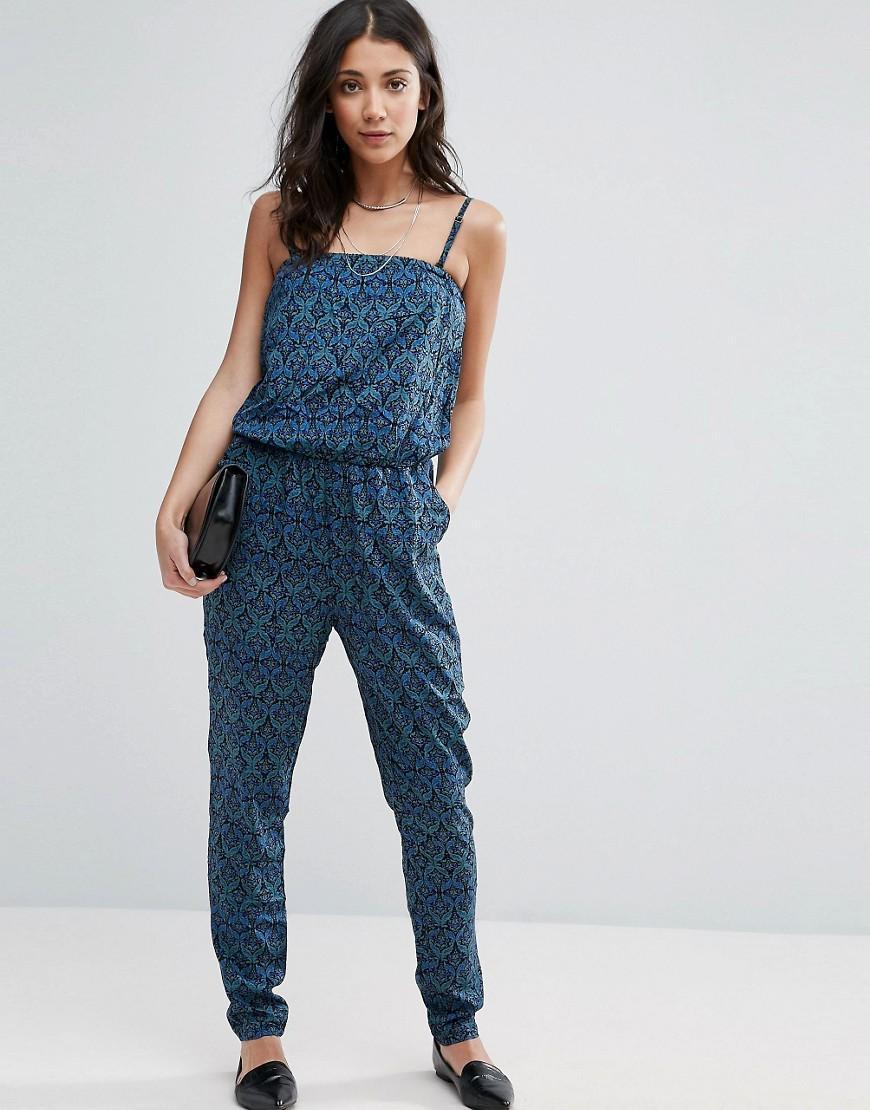 vero moda graphic print jumpsuit in blue lyst. Black Bedroom Furniture Sets. Home Design Ideas