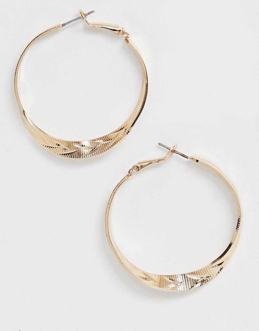 78077a0cbcf5c Lyst - ASOS Hoop Earrings In Twist Design In Gold in Metallic
