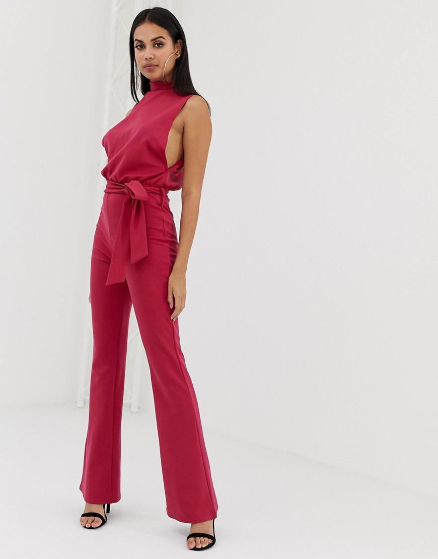 307f44589f47 PrettyLittleThing Scuba High Neck Tie Waist Jumpsuit In Raspberry in ...
