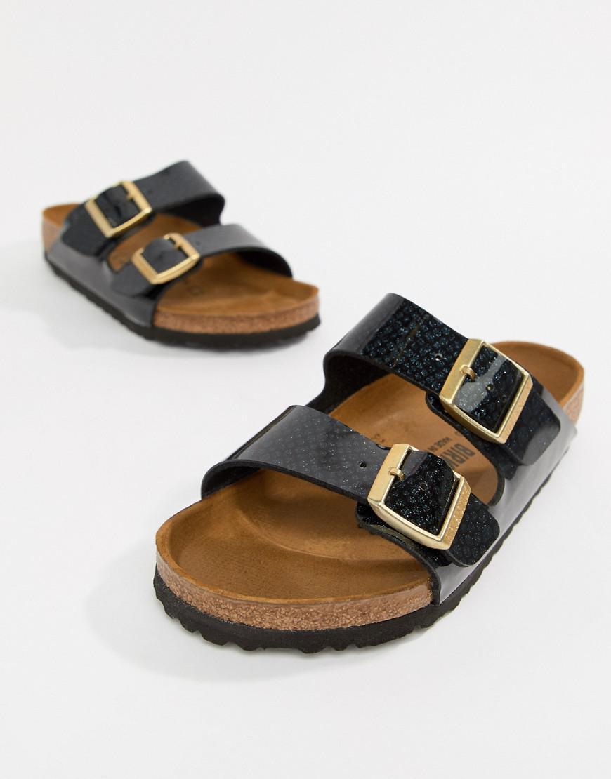 d9fcbb308c79 Birkenstock Arizona Black Magic Print Flat Sandals in Black - Save ...