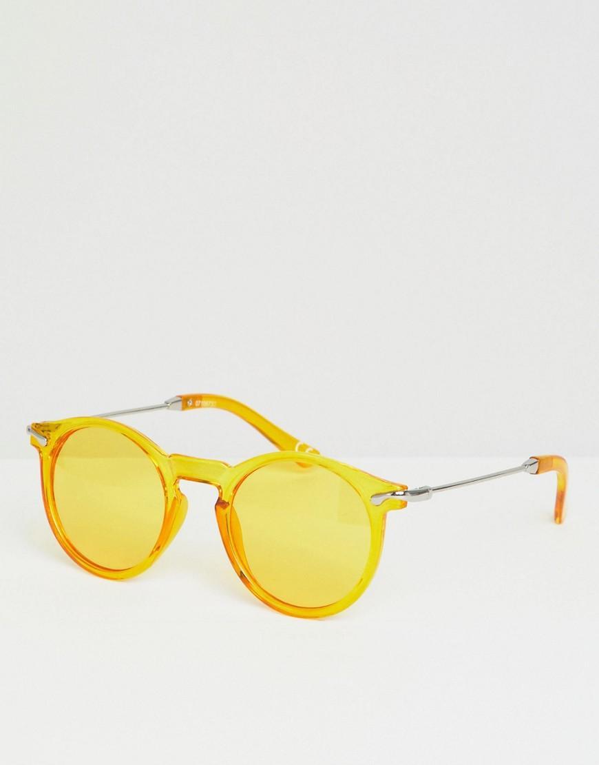 cd0cb6ef2b Gafas de sol redondas en amarillo transparente con lentes en ...