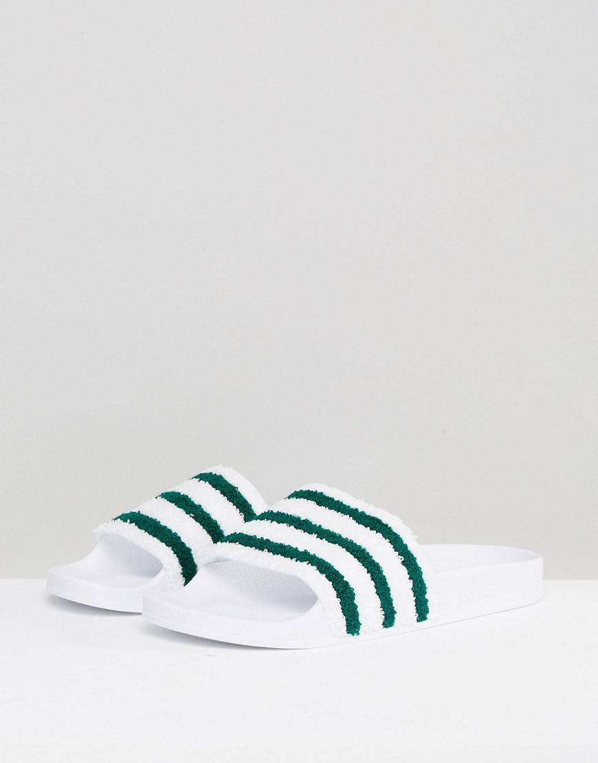 buy online 773e7 d2a6a adidas Originals Adilette Slides In White Bb0124 in White for Men - Lyst
