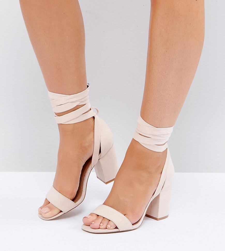 a1078dadffe1 ASOS Wide Fit Howling Tie Leg Block Heeled Sandals in Natural - Lyst