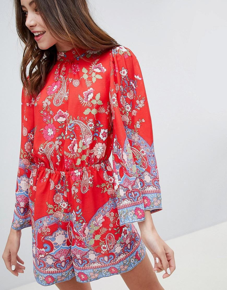 57cfd4ae5eb Miss Selfridge Playsuit With High Neck In Floral Print in Red - Lyst