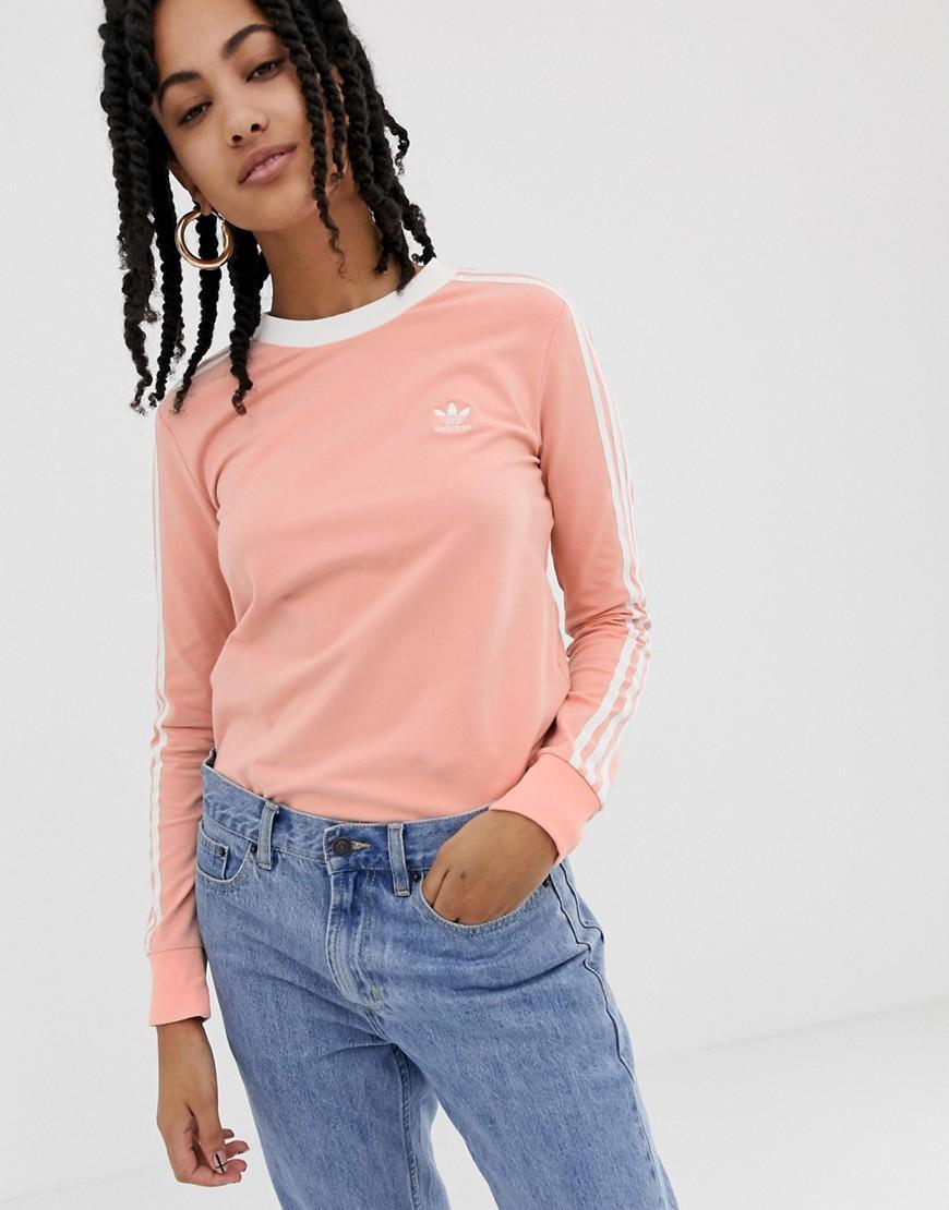 fd71f1b2995 adidas Originals. Women's Adicolor Three Stripe Long Sleeve T-shirt In Pink