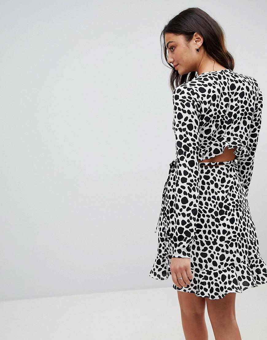 e63233878a9e ASOS Mono Polka Dot Ruffle Wrap Mini Dress in Black - Lyst