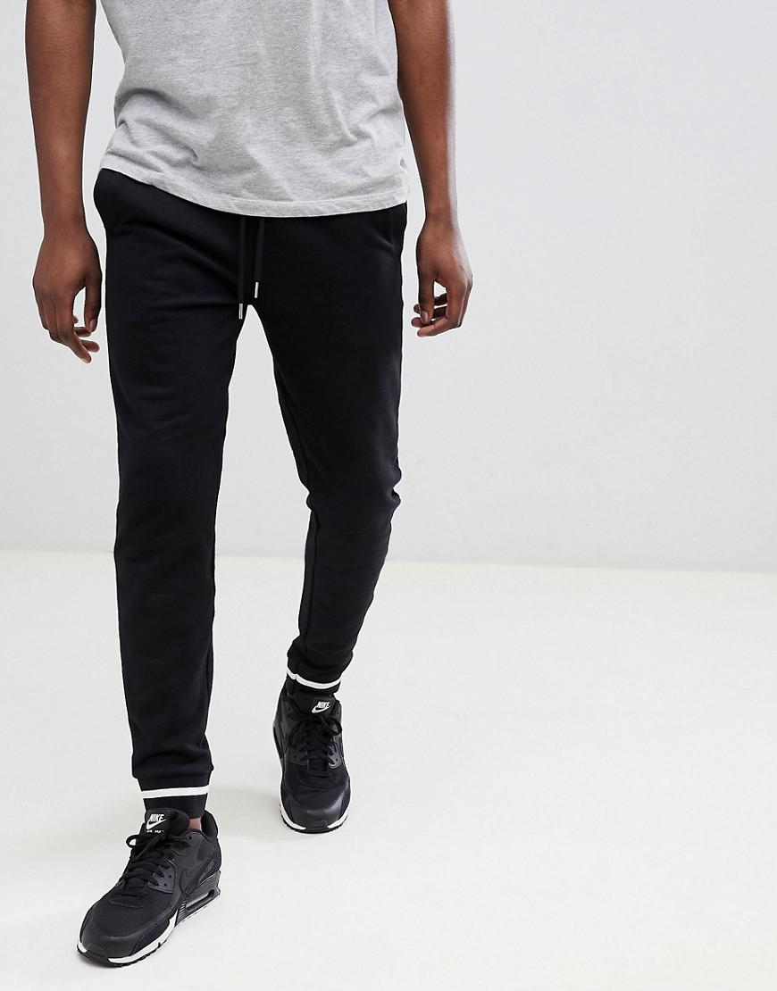 5ef2fd57ab08 Asos Design Skinny Joggers In Black With Contrast Tipping in Black ...