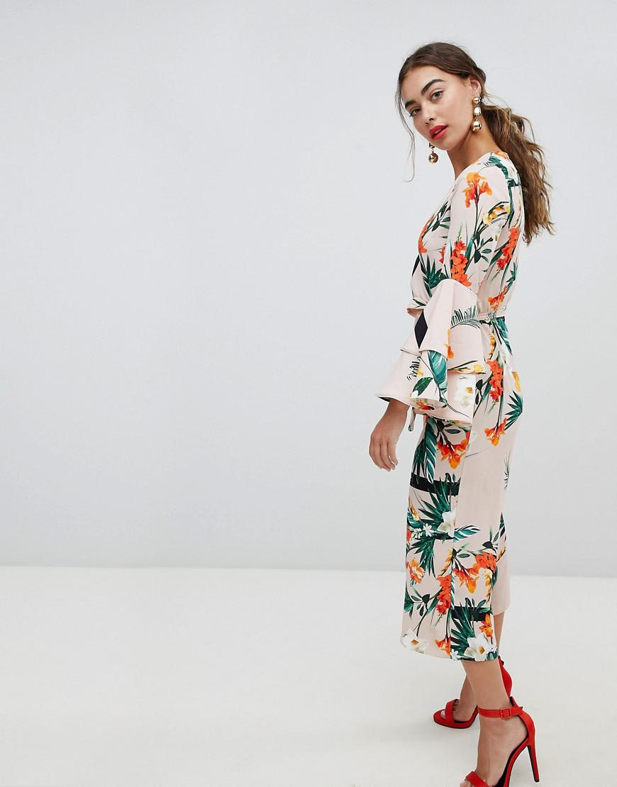 f887dc8ff78 Lyst - River Island Flute Sleeve Tropical Print Jumpsuit in Pink