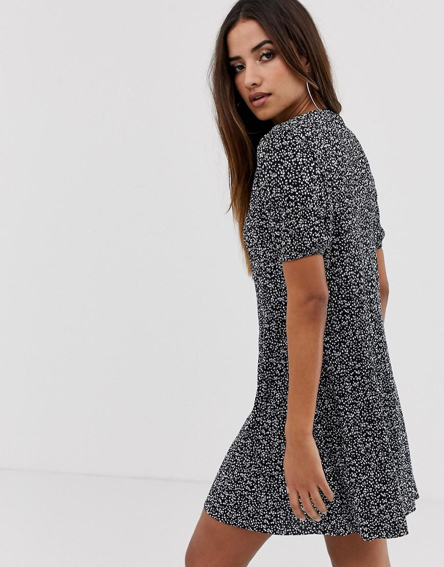 4479703115bfd Lyst - ASOS Mini Plisse Swing Dress With Zip In Ditsy Print