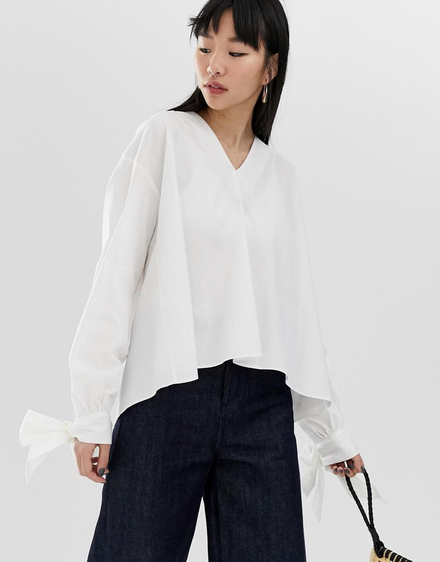 41a777b795a Lyst - Asos Long Sleeve Oversized Top With Tie Cuff In Cotton in White