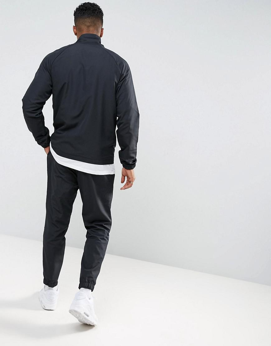 0b22b6571b6e Nike tracksuit set in black in black for men lyst jpg 870x1110 Asos tribute black  nike
