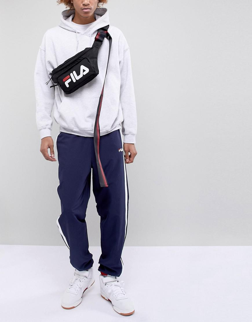 D-ANTIDOTE X Fila Oversized Bumbag With Taping in Black for Men - Lyst 6988c5f7863fe