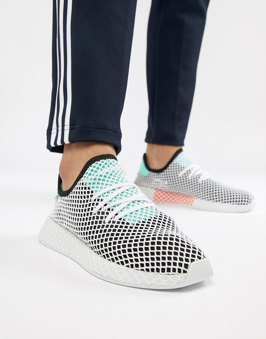 lyst adidas originali deerupt runner formatori in nero b28076 in