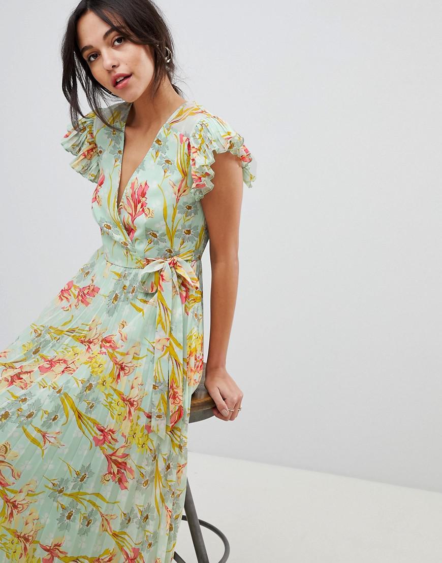 7932900376e Lyst - Robe longue plisse avec manches vases et imprim floral ...