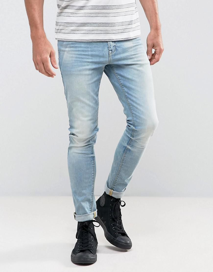 DESIGN super skinny jeans in 12.5oz mid wash blue with knee rips - Mid wash blue Asos High Quality Sale Online Inexpensive Pay With Paypal For Sale Largest Supplier AcWXfY