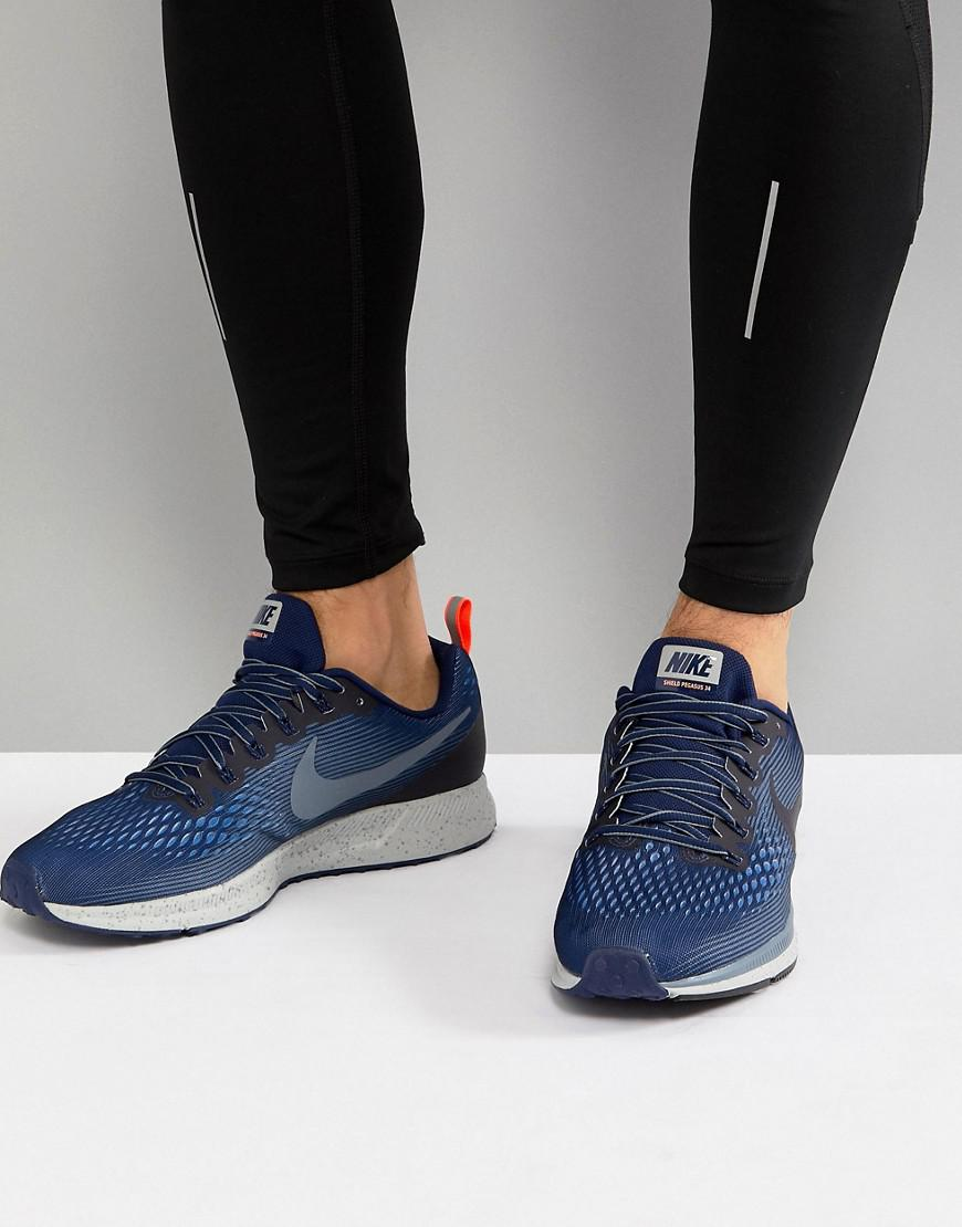 83320376d910a Nike Air Zoom Pegasus 34 Shield Trainers In Blue 907327-400 in Blue ...