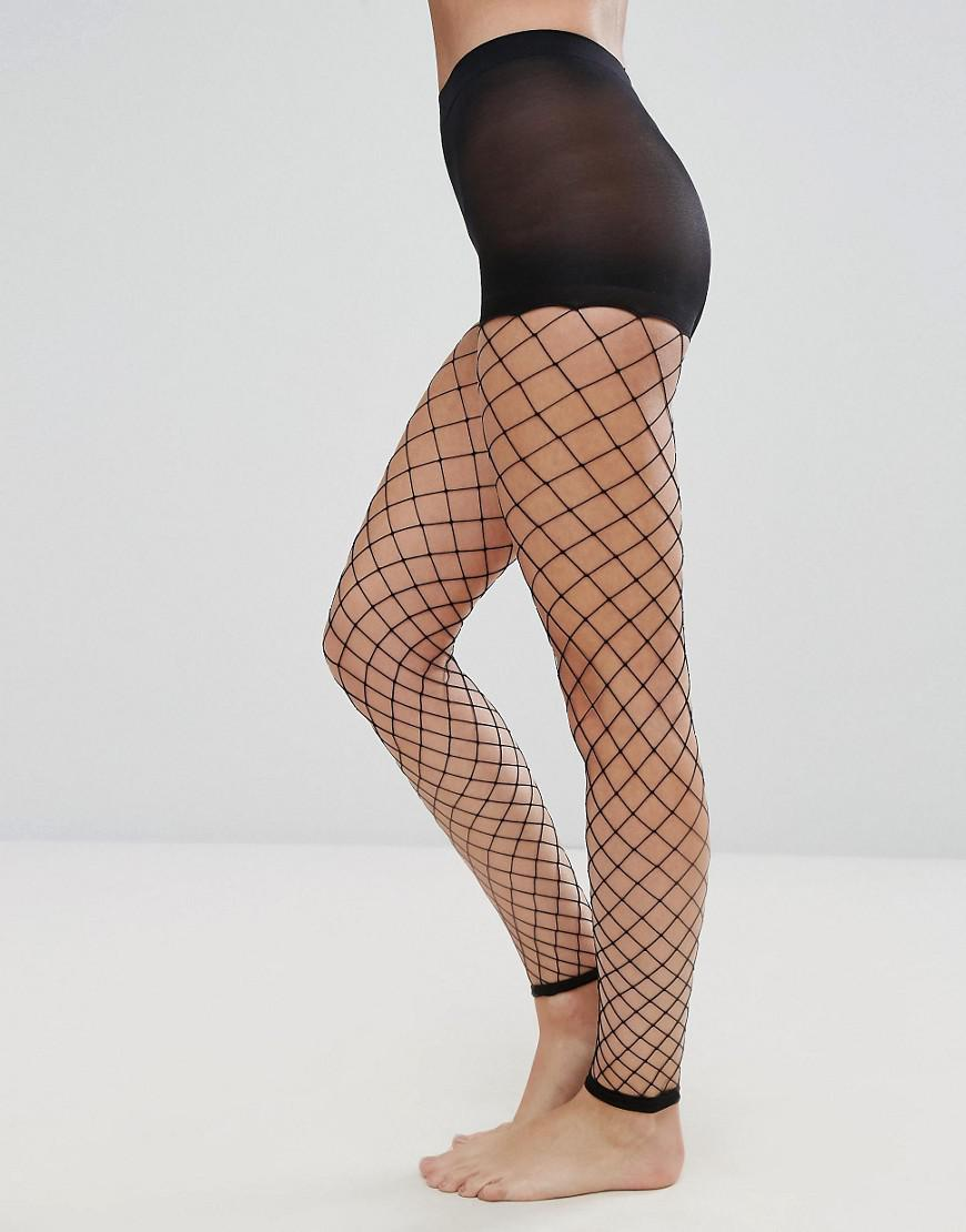 057a3f13ae06b ASOS Asos Oversized Footless Fishnet Tights in Black - Lyst