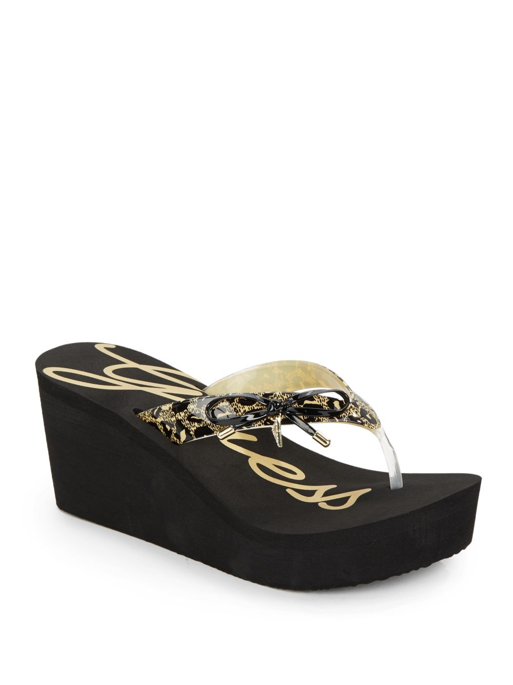 e2d0a4c97b7 Lyst - Guess Syona Leopard-Print Bow Platform Wedge Sandals in Black