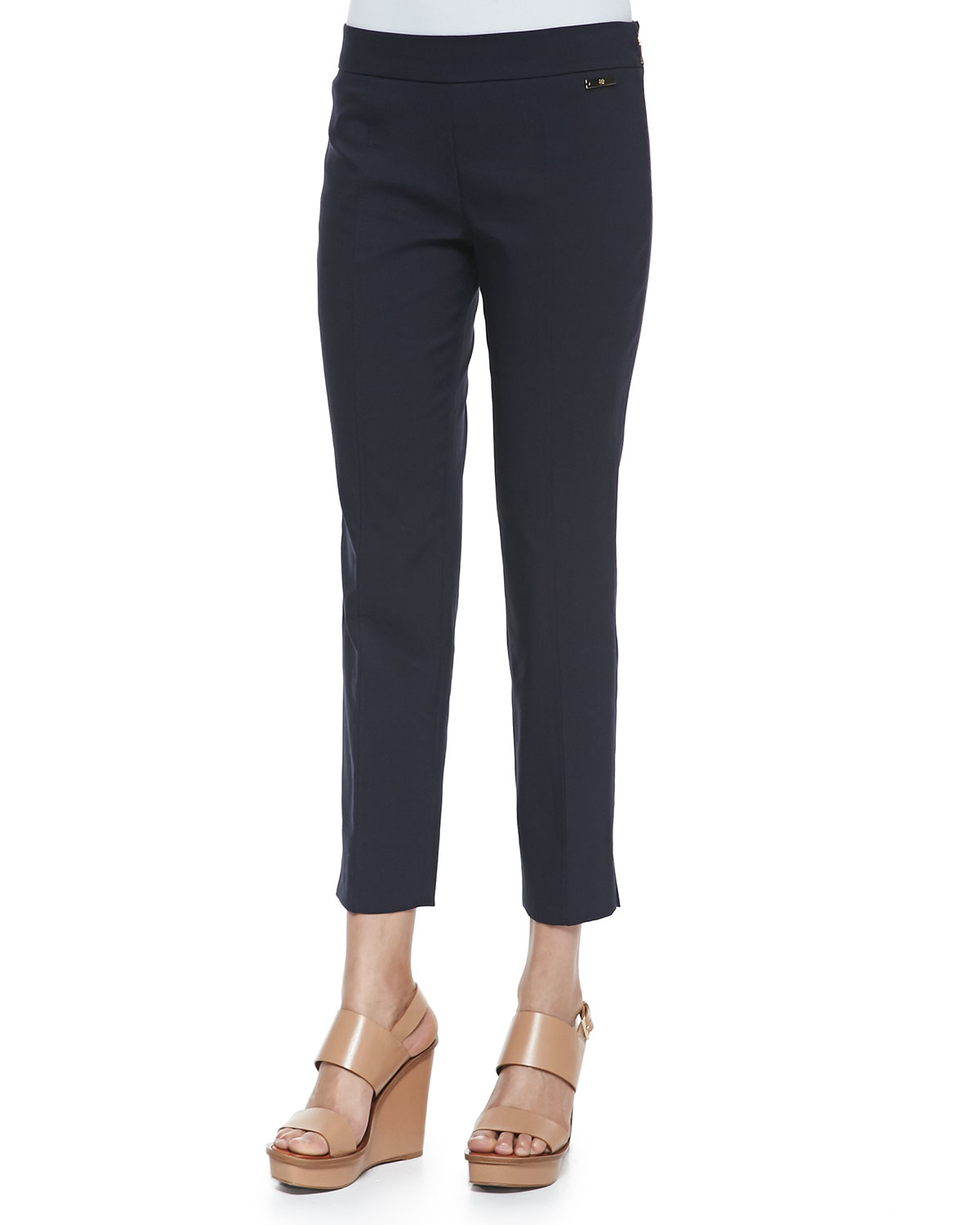 Our skinny ankle pants come in tons of fun colors and patterns. If you want to show off your bold personality, opt for our red or pink colored pants with a blouse and statement necklace to complete the look. Our neutral colored skinny ankle pants are perfect for more formal meetings in the office.