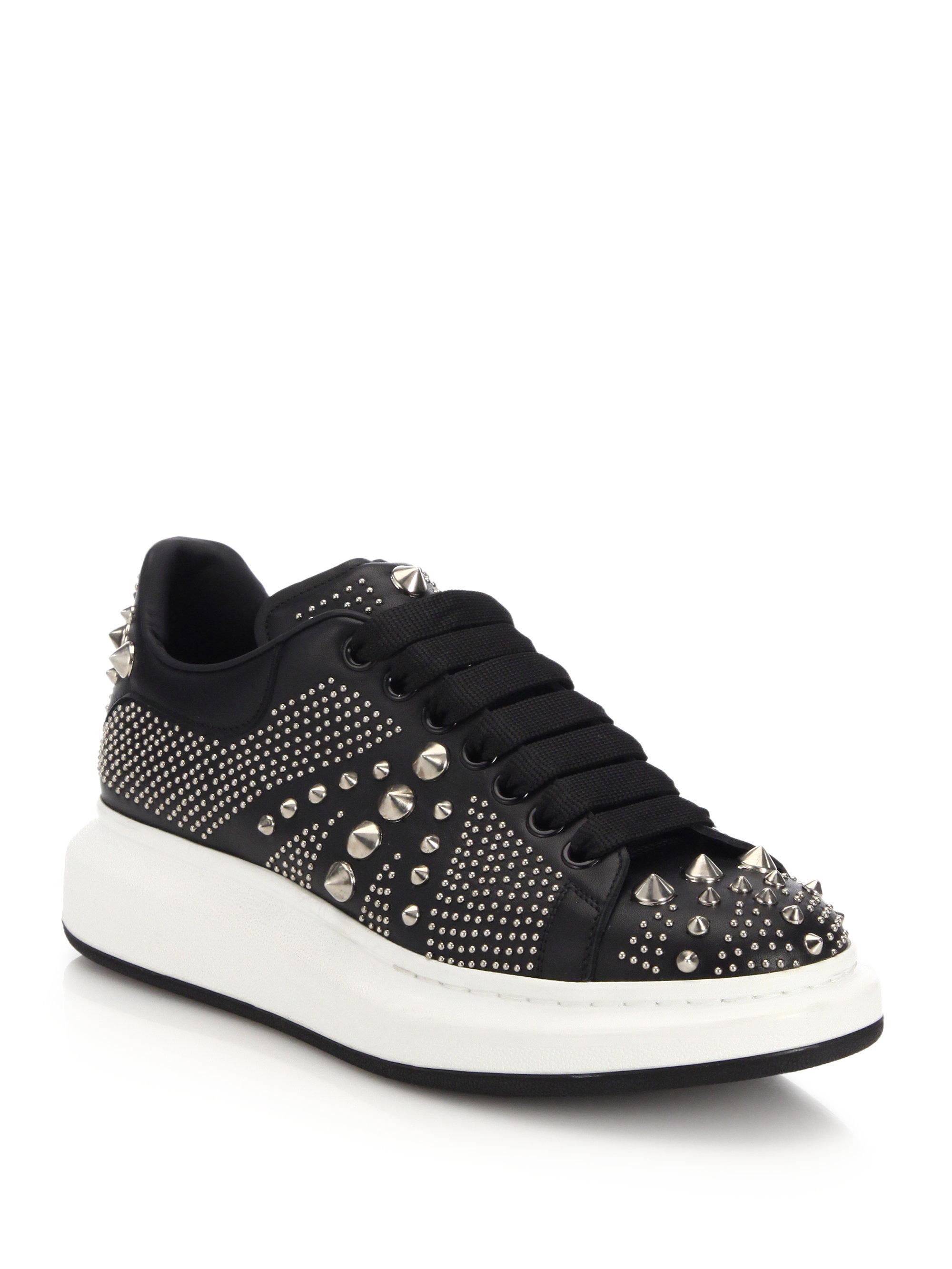Studded leather sneakers Alexander McQueen 4IIDE73
