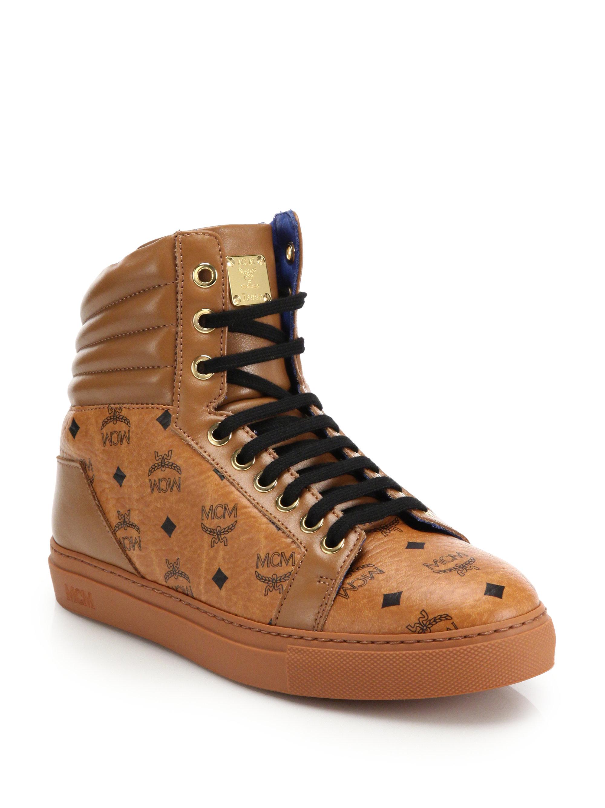 mcm logo high top sneakers in brown lyst