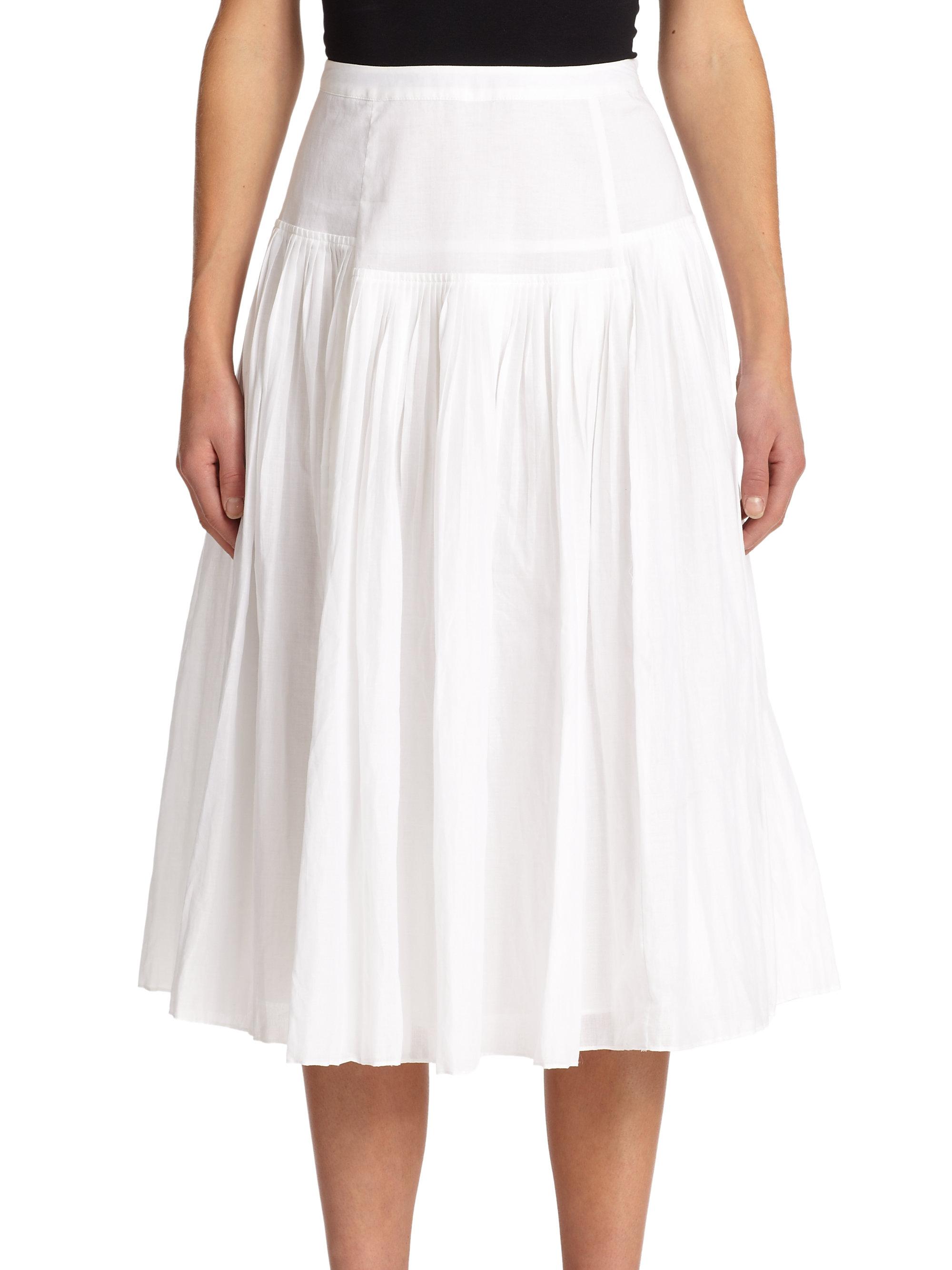 pleated midi skirt in white lyst