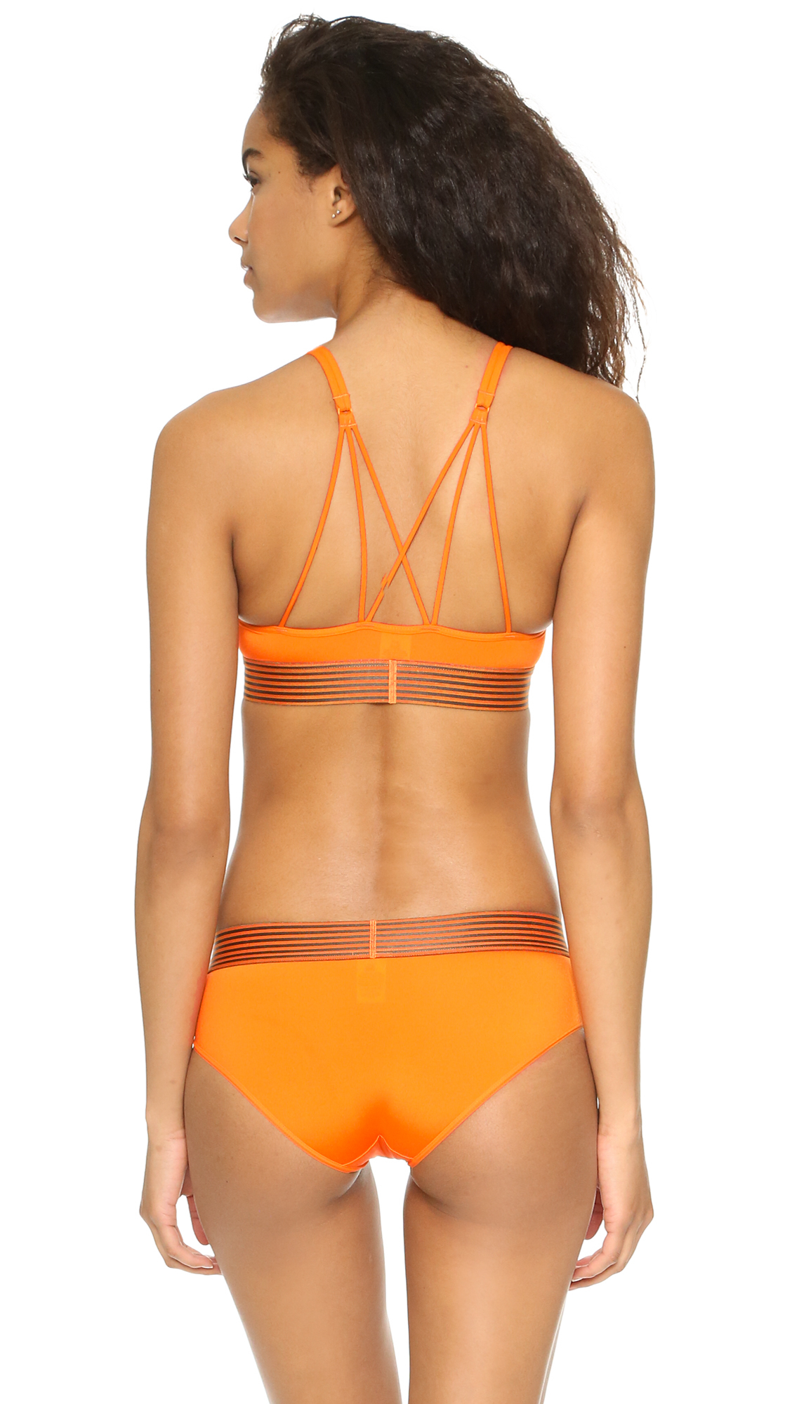 7d56be35d7 Lyst - Calvin Klein Iron Strength Micro Bralette in Orange