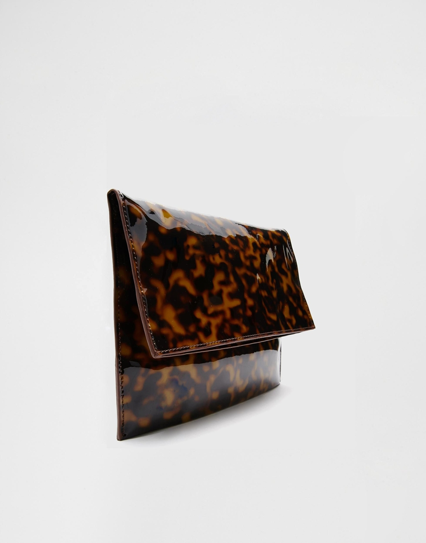 e096734c744 Lyst asos tortoiseshell clutch bag in brown jpg 870x1110 Tortoise shell bag
