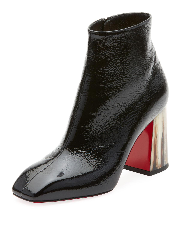 2e52b25a27c Christian Louboutin. Women s Black Hilconico Vintage Shiny Red Sole Booties