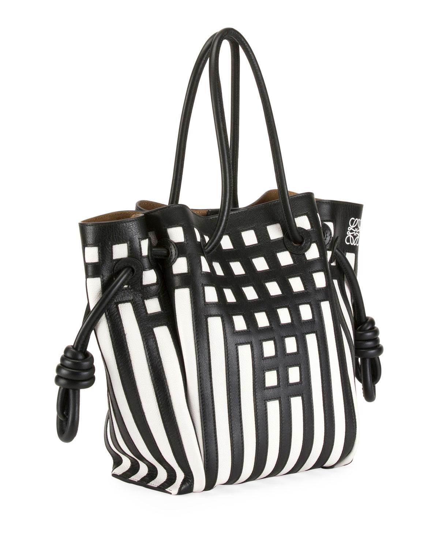 af7bbe111dcc Lyst - Loewe Flamenco Knot Grid Leather Tote Bag in Black - Save 16%