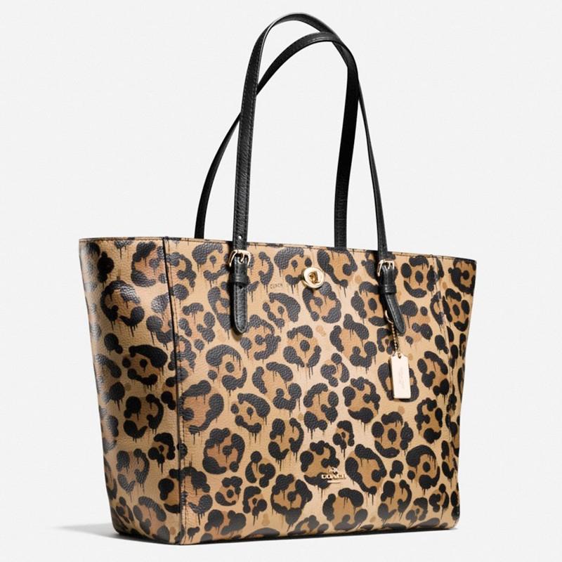 3cbb19472352 ... leopard shoulder handbags 6b7e1 c151c; sale coach turnlock leather tote  bag lyst 309e1 52d58