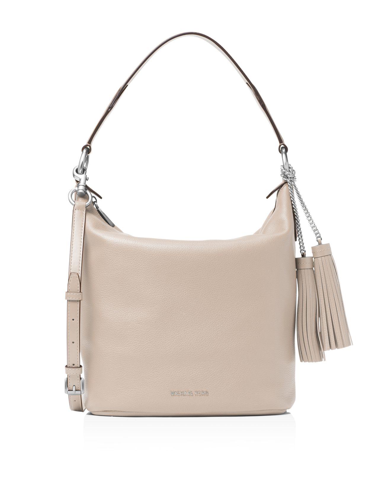 MICHAEL Michael Kors Lupita Medium Leather Messenger Bag in Black - Lyst 0a230119d3