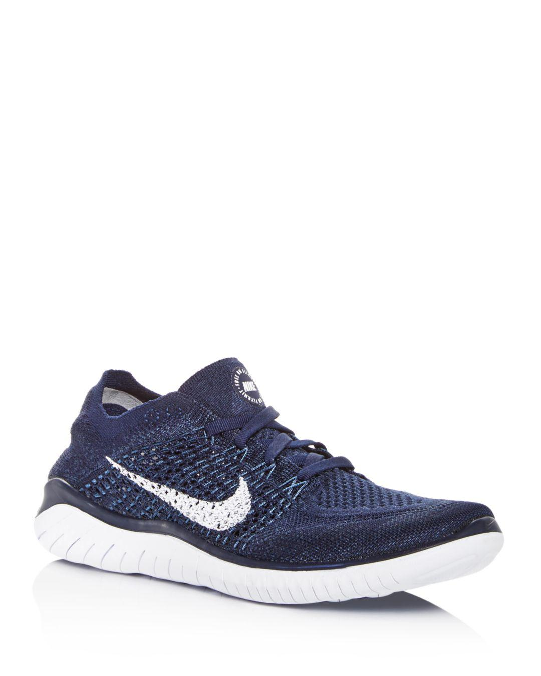 a2b5bd2e212a Lyst - Nike Men s Free Rn Flyknit Lace Up Sneakers in Blue for Men