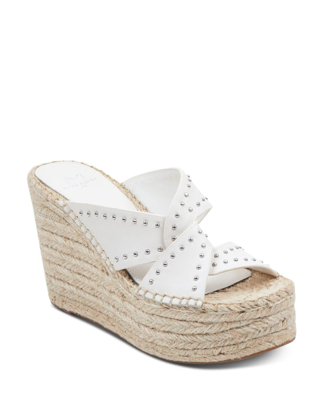 9555665f2f4 Lyst - Marc Fisher Angelina Wedge Sandals in White - Save 26%