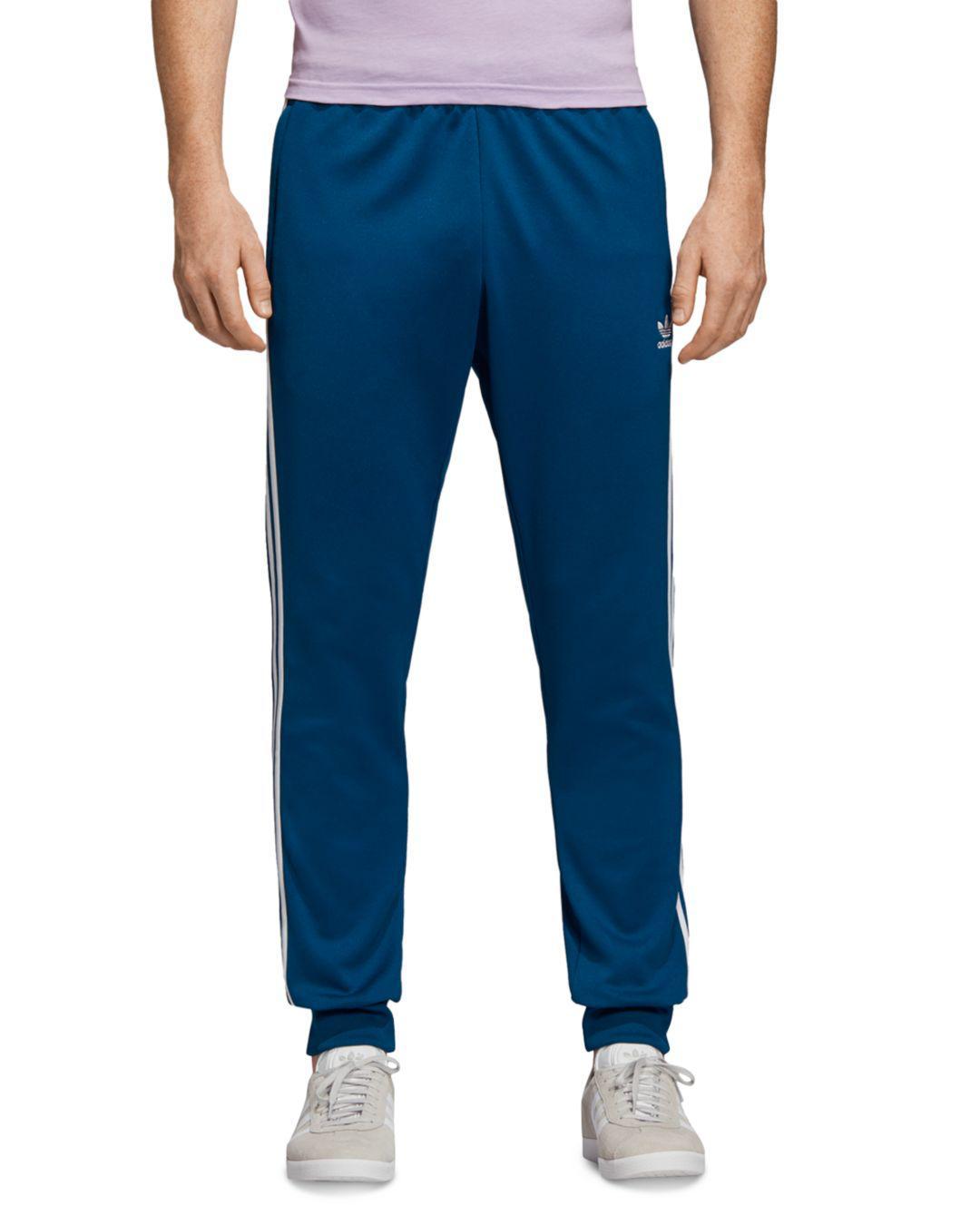 on sale 185bd eb4ae adidas Originals. Mens Blue Superstar Track Trousers