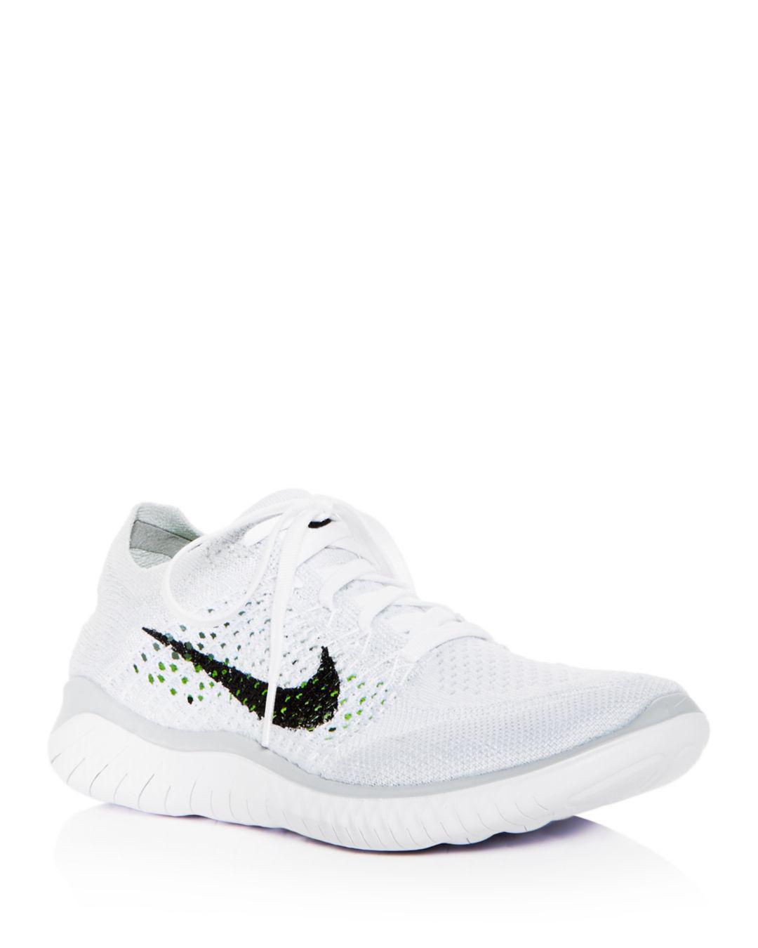 5fdad4f294e1 Lyst - Nike Women s Free Rn Flyknit 2018 Lace Up Sneakers in White