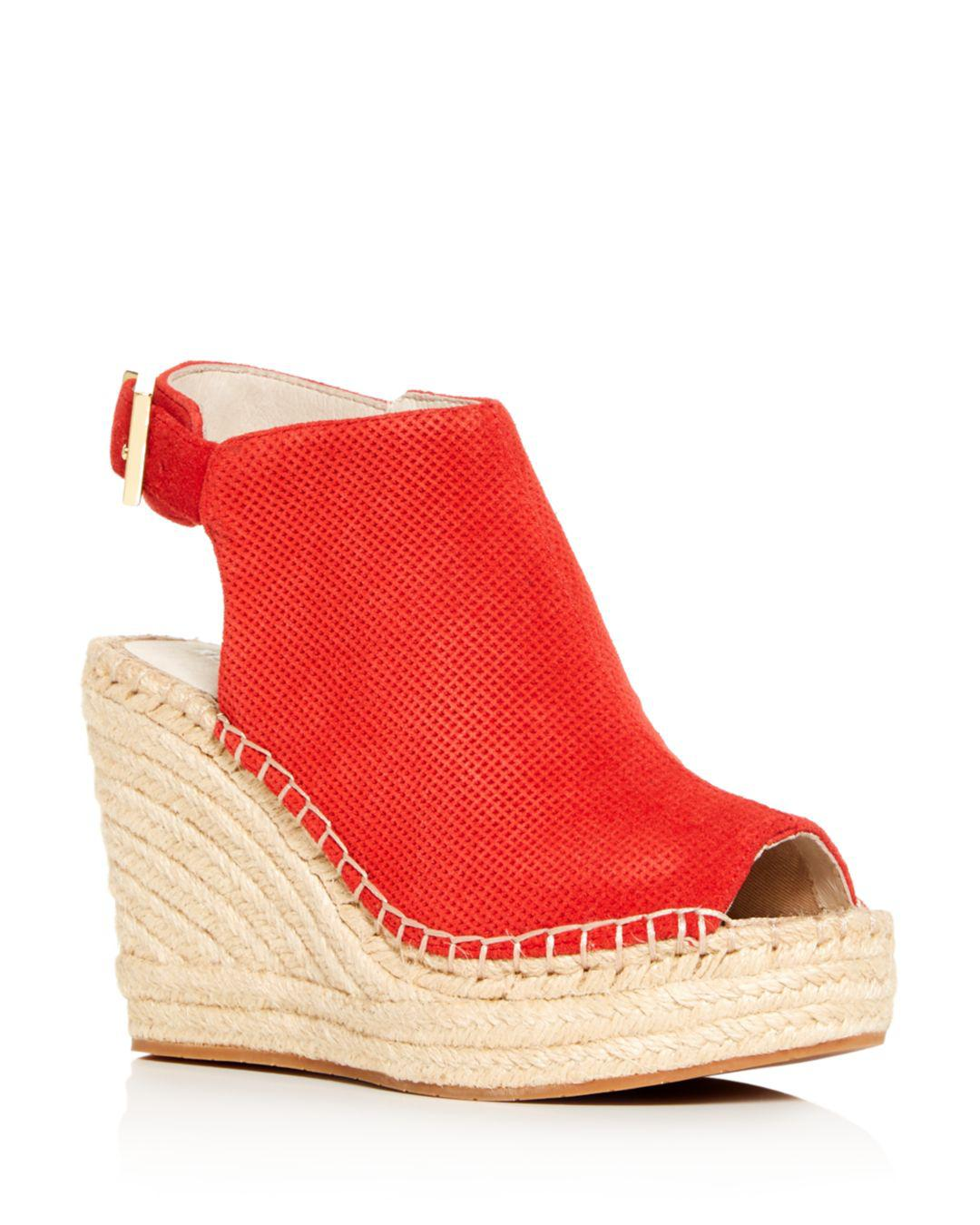 761cdbb5ef3 Kenneth Cole. Women s Olivia Perforated Platform Wedge Espadrille Sandals