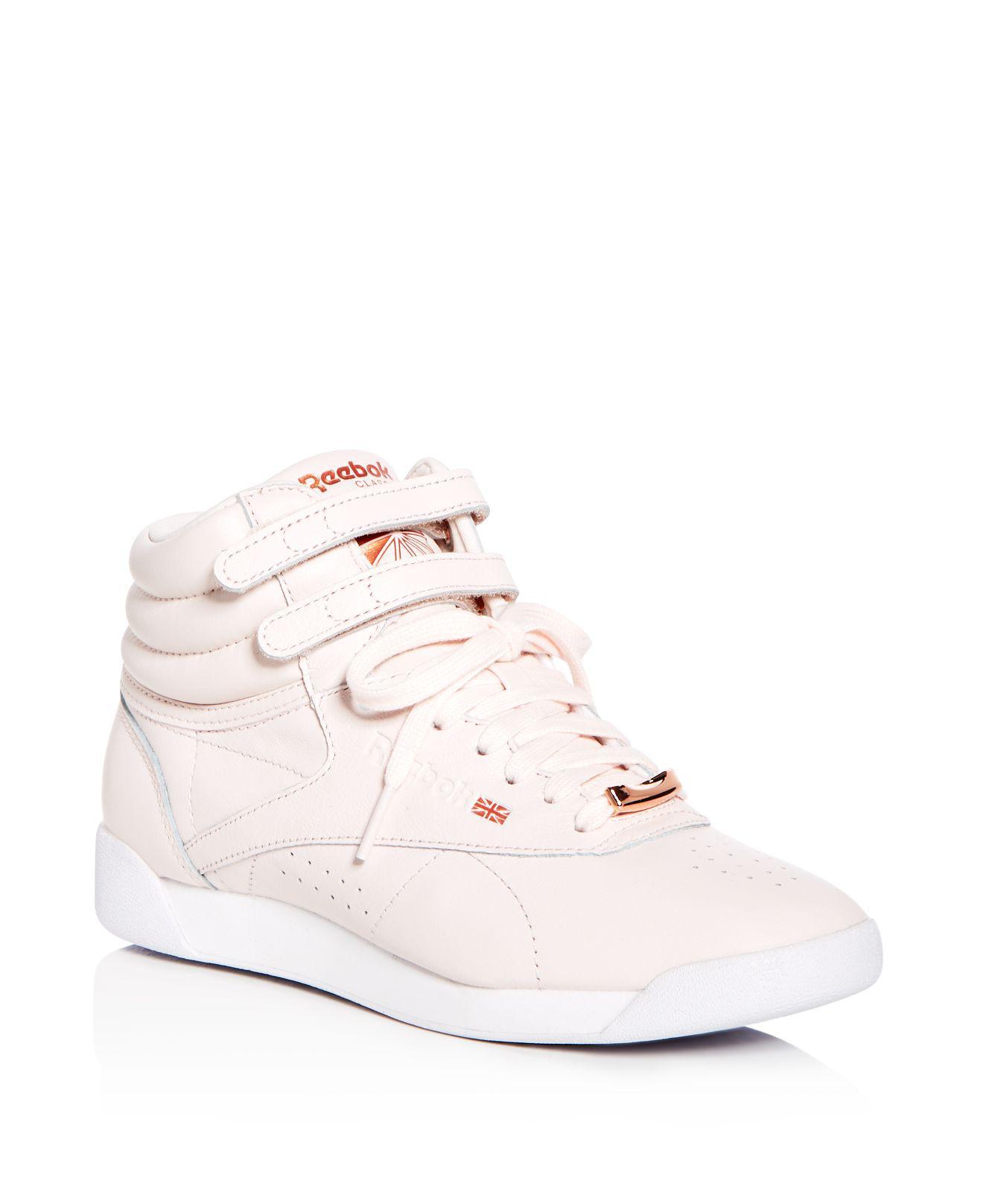 Reebok Women's Freestyle Hi Leather High Top Sneakers 61YztPjWS