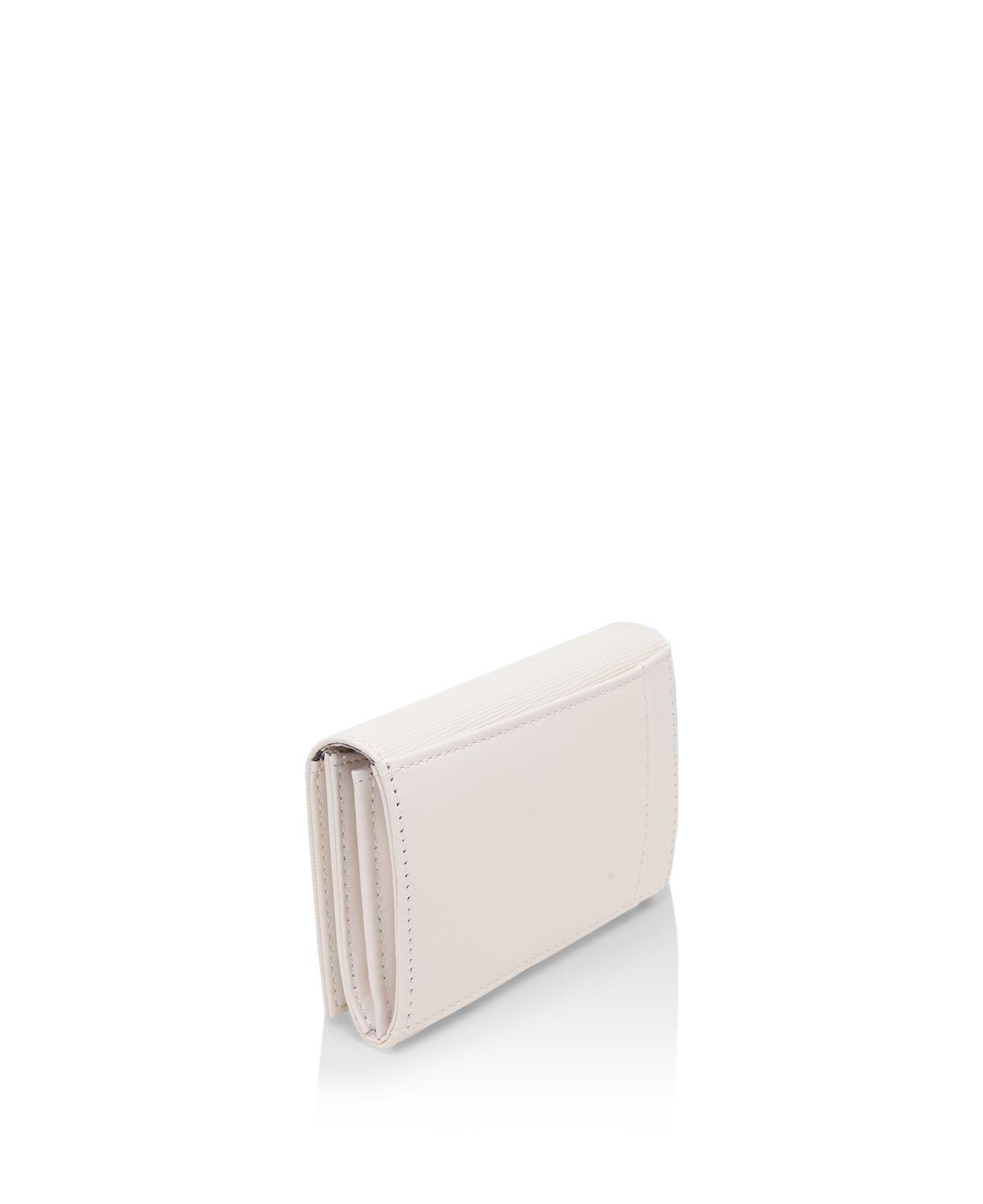 59d57fe41fef7 Lyst - Ted Baker Myah Curved Bow Mini Wallet