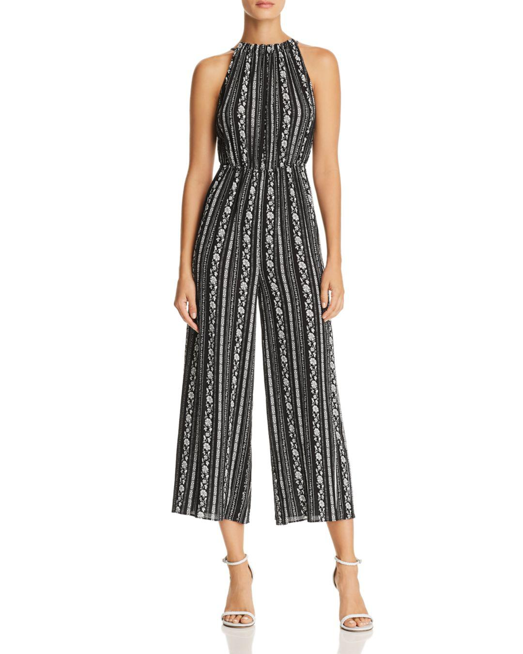 be19002ca964 Aqua - Black Floral Gauze Wide-leg Jumpsuit - Lyst. View fullscreen