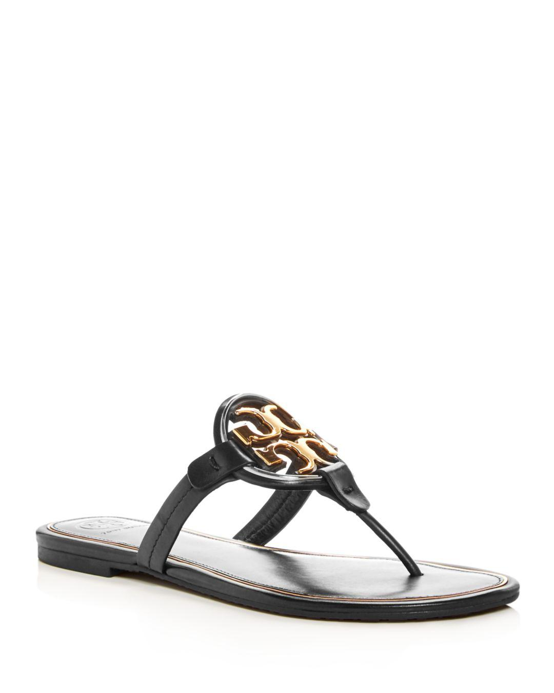 4d811ec9b5ed Lyst - Tory Burch Miller Logo Thongs In Black And Gold Leather in ...