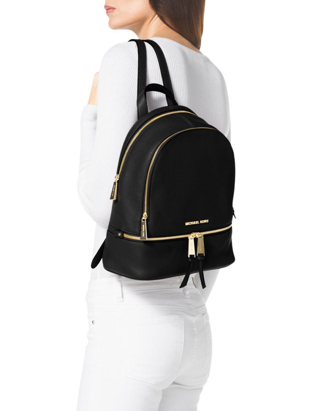 7d3ba31672fd MICHAEL Michael Kors Small Rhea Zip Backpack in Black - Save 43% - Lyst