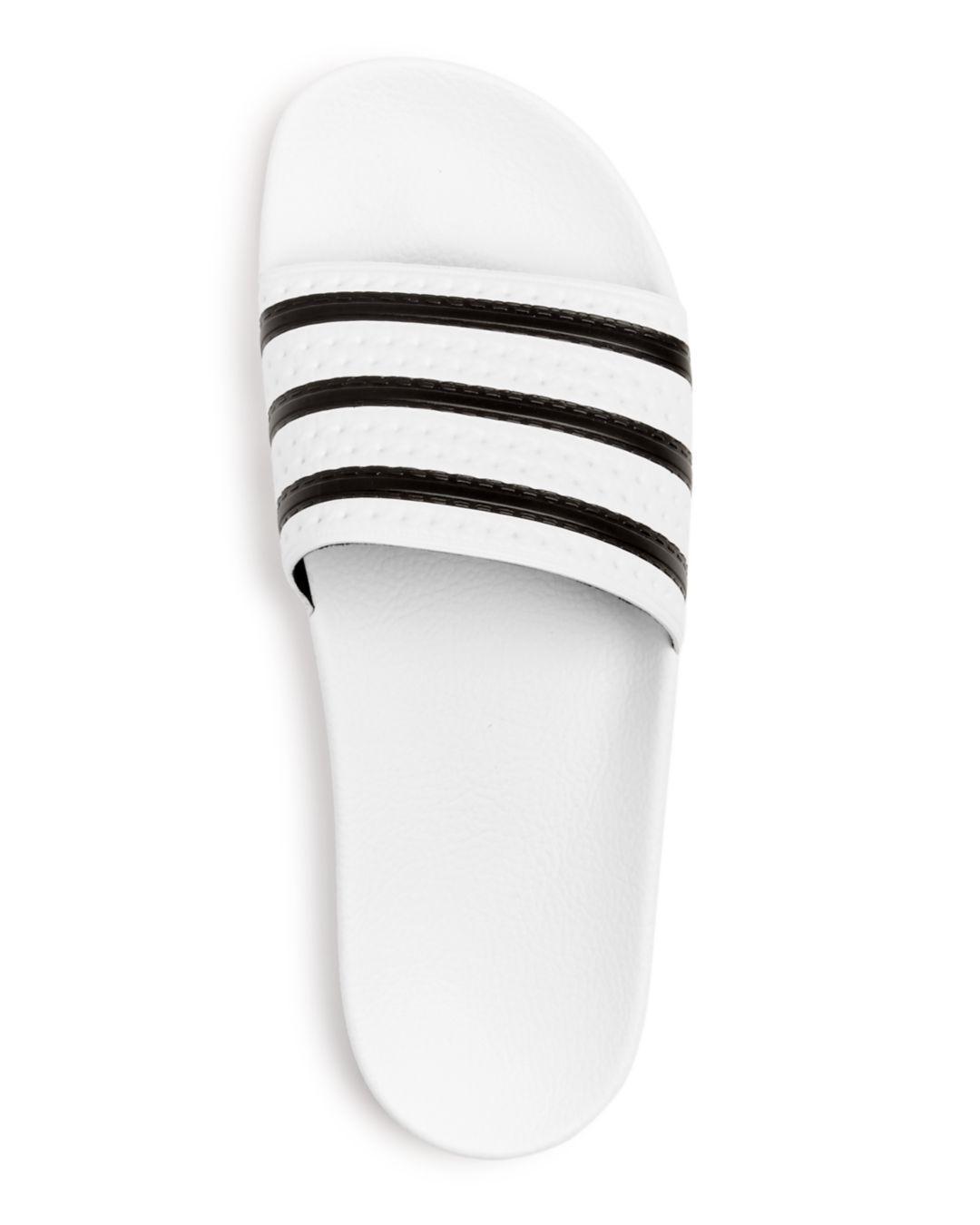 5891c34c436cc Lyst - adidas Adilette Slide Sandals in Blue for Men - Save  38.983050847457626%