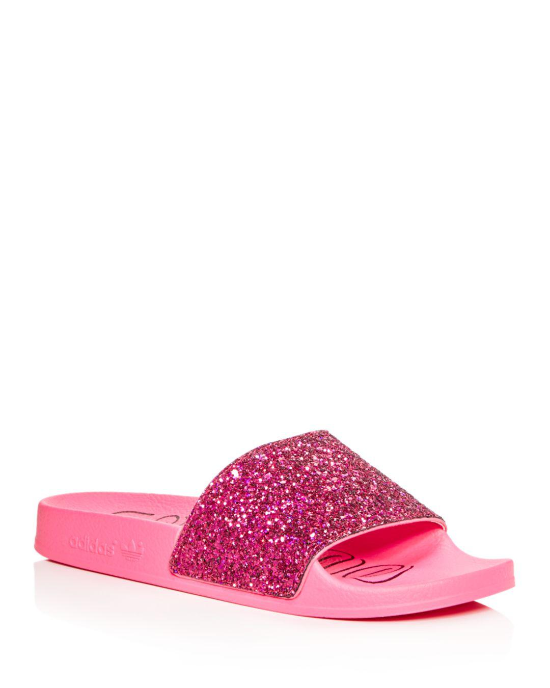 061a3b0278f adidas Women s Adilette Glitter Slide Sandals in Pink - Lyst