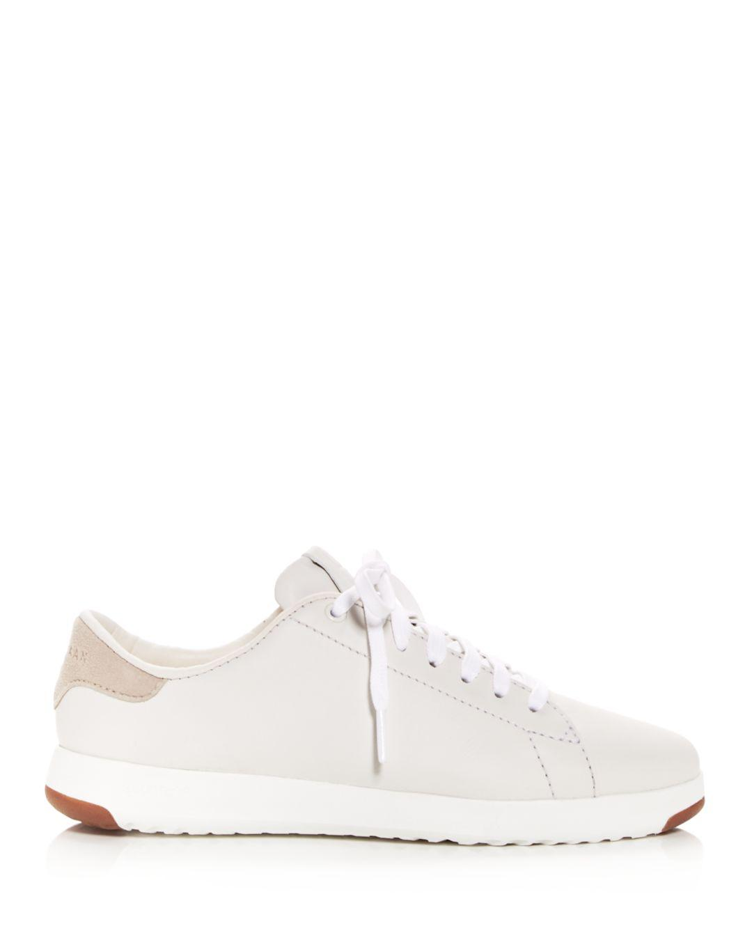 c249544d9ae Lyst - Cole Haan Women s Grandsport Leather Lace Up Sneakers in White