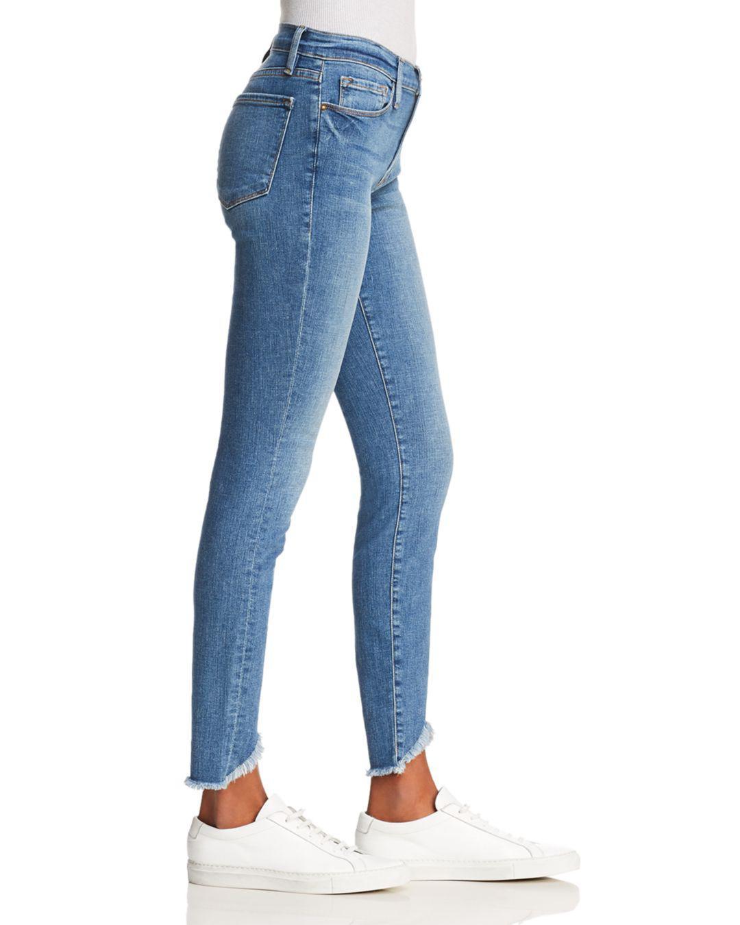 Lyst - Frame Le Skinny De Jeanne Triangle Hem Jeans In White Chapel ...
