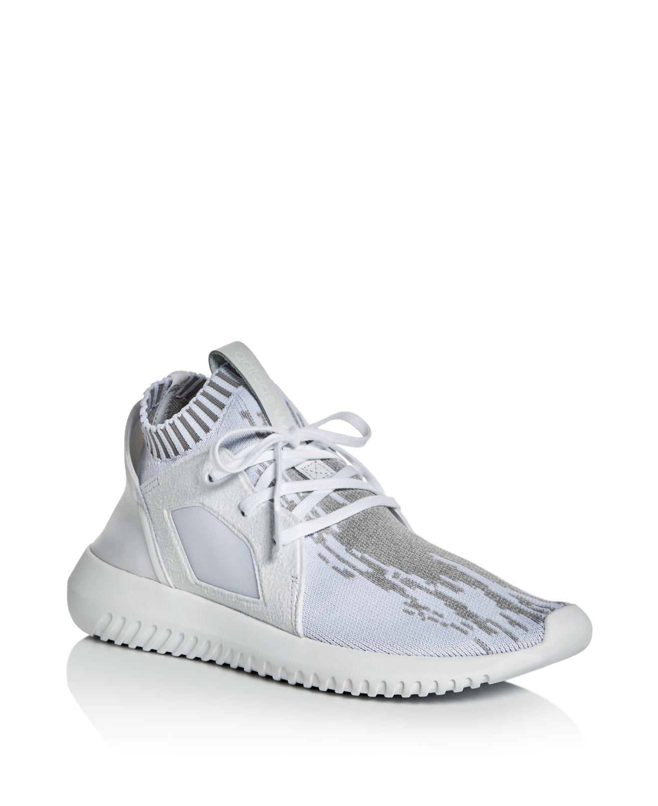 cheap for discount a4b8d 7ef74 Lyst - adidas Originals Women s Tubular Defiant Primeknit Lace Up ...