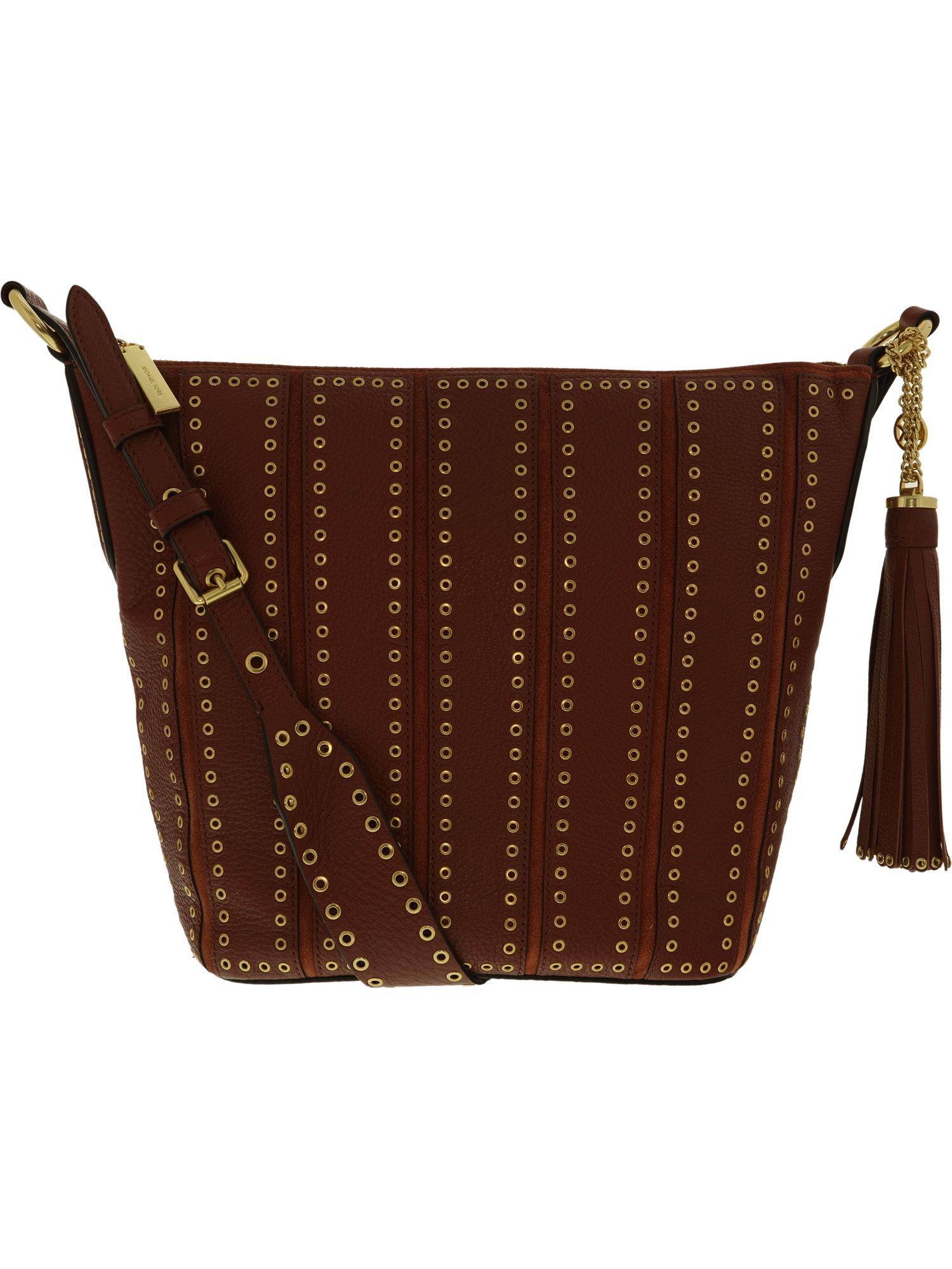 682f3e7ea008 Michael Kors. Orange Women's Medium Brooklyn Grommet Leather Feed Bag ...