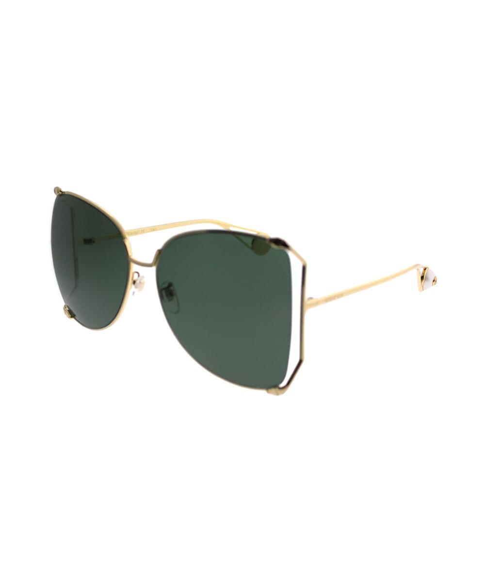 063a30f1cc3 Lyst - Gucci Gg0252s 005 Gold Round Sunglasses in Metallic