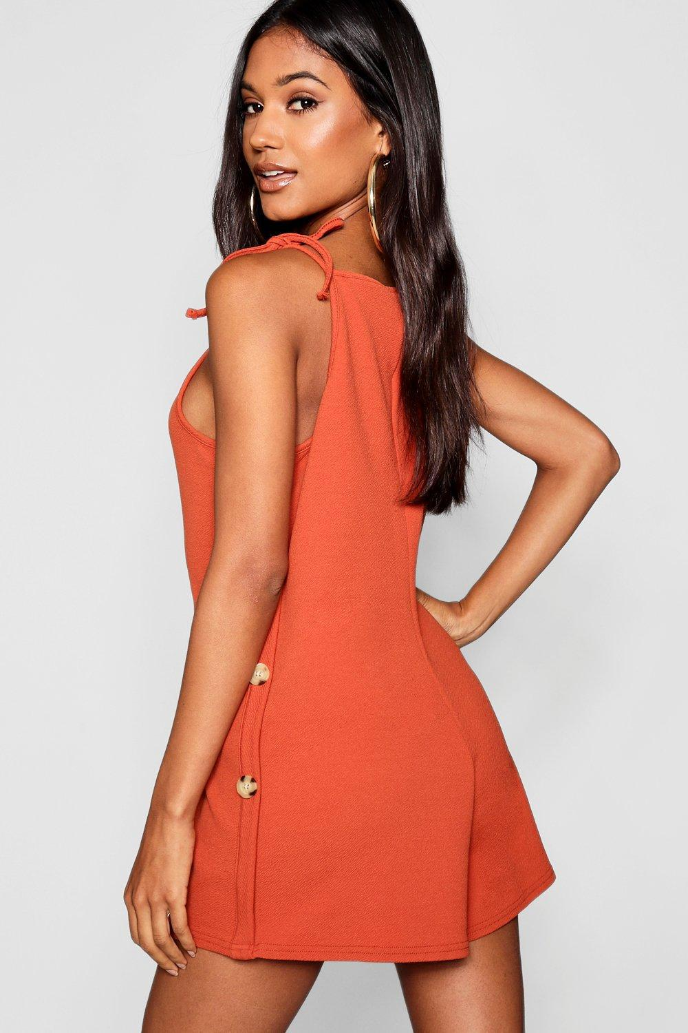 53fc602d460 Boohoo Apron Neck Horn Button Playsuit in Orange - Lyst